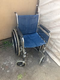 blue and black wheelchair with gray metal base null