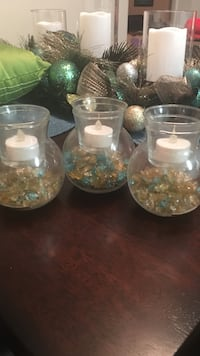 three clear glass tealight candle holders
