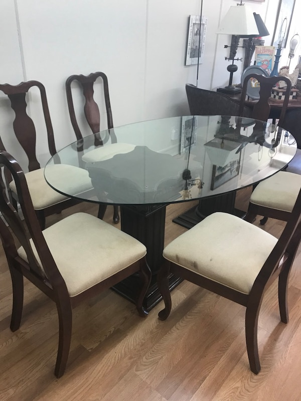Used Brown Oval Glass Top Dining Table With 6 Chairs 70 X 45 For