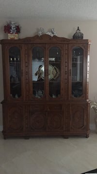 Brown wooden framed glass display cabinet Montréal, H1S 3G3