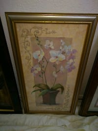 brass-colored wooden framed white orchid painting