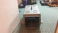 """Small animal transport or sleep container 24"""" long by 26"""" wide by 15 """" high. Door swings one way with double locking rides top and bottom. Glocester, 02814"""