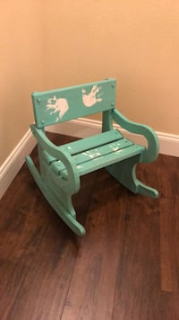 green wooden rocking bench