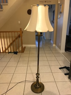 brass base with beige cone floor lamp shade