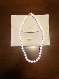 New.  Pearl necklace and earrings .