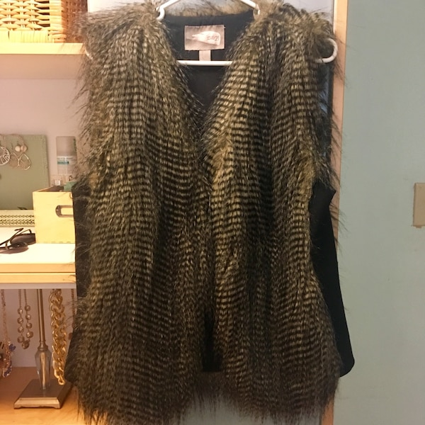 brown fringed coat