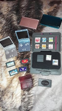 black Nintendo DS with game cartridges 44 km