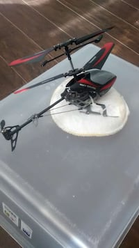 black and red RC helicopter