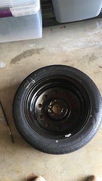 black bullet hole car wheel with tire Port Orchard, 98366