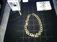 gold-colored necklace