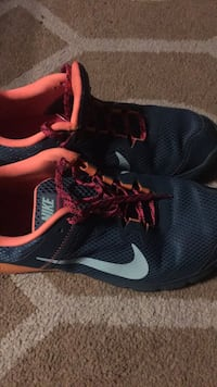 Pair of black-and-pink nike running shoes.