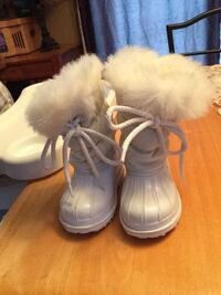 Pair of white fur duck winter boots