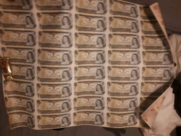 uncut sheets of old 1dollar and 2 dollar bills