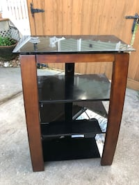 brown wooden frame glass top TV stand Houston, 77018