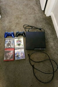 Sony PS3 slim w/ 2 controllers and 4 games Tallahassee, 32303