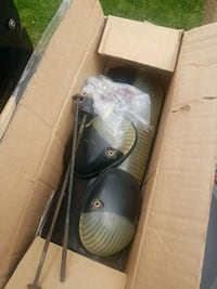 pair of black leather shoes in box