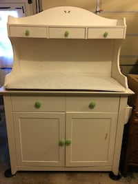 Baby changing table/cabinet/shelving unit.