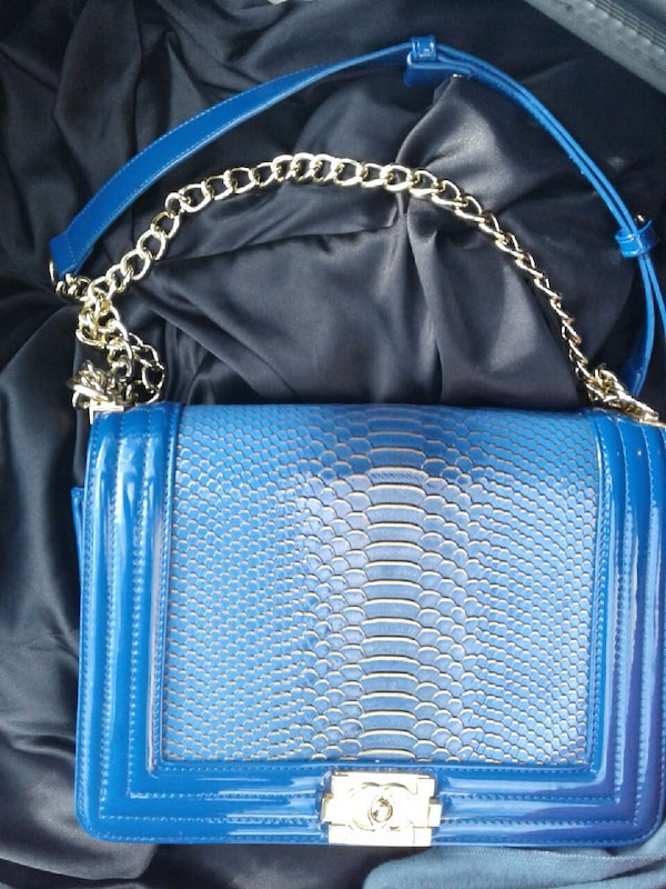 Used blue leather sling bag for sale in Minneapolis - letgo c57ff2304ceb2