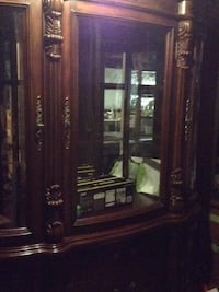 brown wooden framed glass display cabinet Frederick, 21703