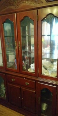brown wooden framed glass display cabinet 548 km