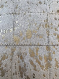 Gold and tan cowhide throw pillow