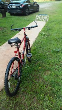 red and black hardtail mountain bike Central, 29630