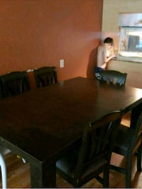 rectangular brown wooden table with six chairs din Longueuil, J4H 3R7