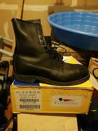 pair of black leather work boots on box