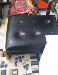 black leather padded rolling armchair North Saanich, V8L 5S6