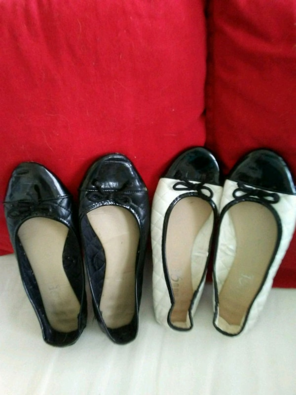 two pairs of black/white leather flats