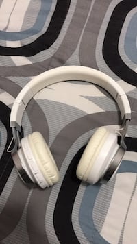 White and gray corded headphone