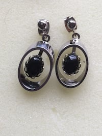 Pair of silver and black onyx pendant earrings