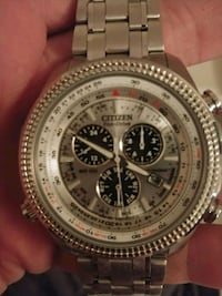 round silver-colored chronograph watch with link bracelet 819 mi