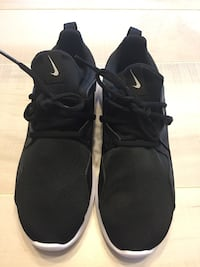 pair of black Nike running shoes Gaithersburg, 20879