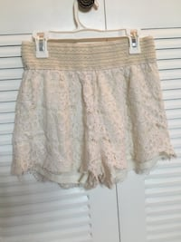Shorts size small never used has no tags stretchy dress up or down