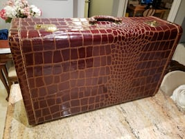 Antique crocodile suitcase.