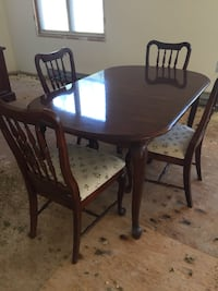 Round brown wooden table with four chairs dining set Toms River, 08753