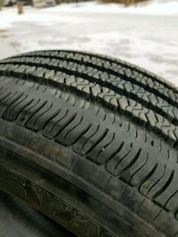 black car tire with tire Minot, 58701