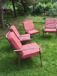 Patio table and steel chairs and new cushions