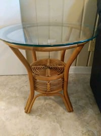 End table. Wicker with glass top. 24 in dia. Arlington, 22202