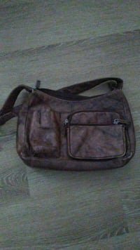 purple and black leather sling bag