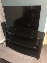 black flat screen TV with black wooden TV stand Medford, 11763