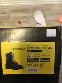 Pair of black leather steel toe work boots with box