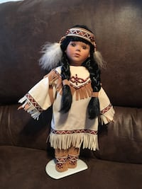 Porcelain Native American doll with baby
