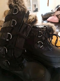 Guess black knee high winter boots.  Aurora, L4G 2B8