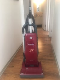 red and black upright vacuum cleaner Victoria, V9A 3L7