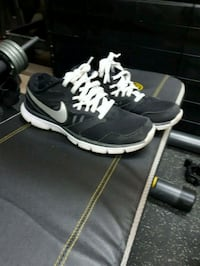 pair of black-and-white Nike running shoes Montreal, H1C 0B2