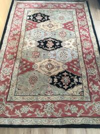 Red, white, and black floral area rug Coquitlam, V3K 5T6