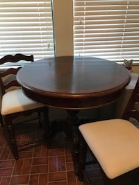 round brown wooden table with four chairs Visalia, 93292