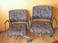 two gray-and-black floral padded armchairs 494 mi